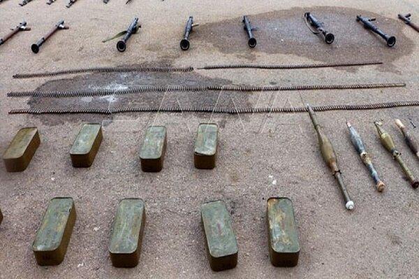 کشف مقادیری سلاح از بقایای تروریست ها در حومه غربی استان درعا